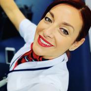 Paola  A. headshot